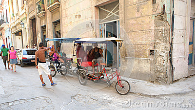 Homemade tricycle. The old streets of Havana. Editorial Photography