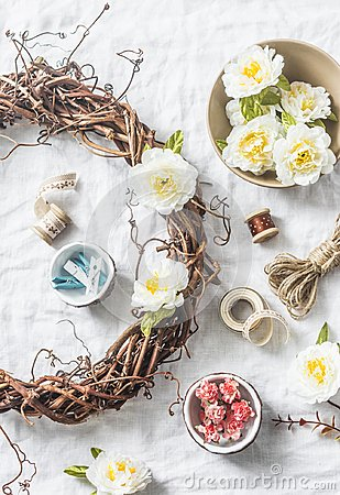 Free Homemade Wreath With Flowers And Accessories For Crafts Creativity On A Light Background, Top View. Royalty Free Stock Photo - 107305965