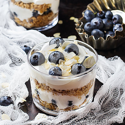 Homemade yogurt with granola muesli and blueberries