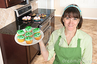 Homemaker holding cupcakes