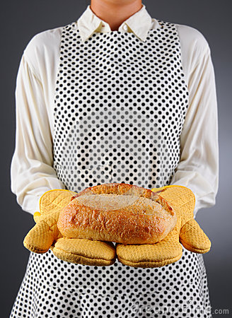 Homemaker Holding Fresh Loaf of Bread