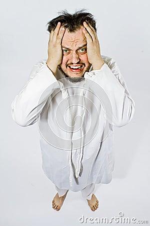 Homme aliéné dans la camisole de force