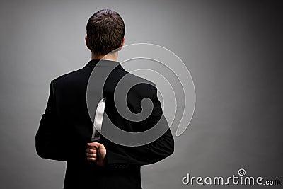 Homme d affaires avec le couteau