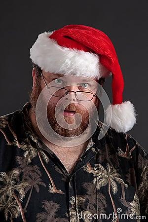 Homme obèse dans le chapeau de Santa