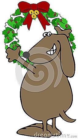 Hond die een kroon van Kerstmis hangen
