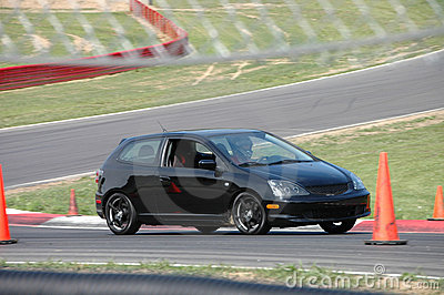 Honda Civic Si driving on Race Course
