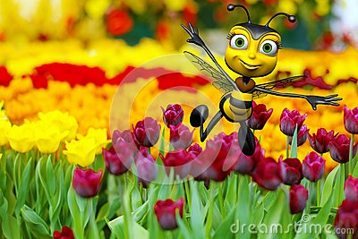 Honey bee flying above the flowers