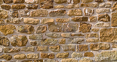 Honey-coloured stone wall background