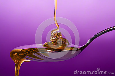 Honey dripping on spoon