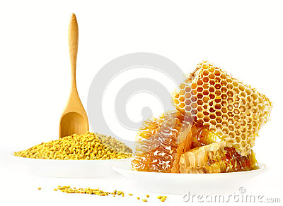 Honey honeycombs and pollen on plates
