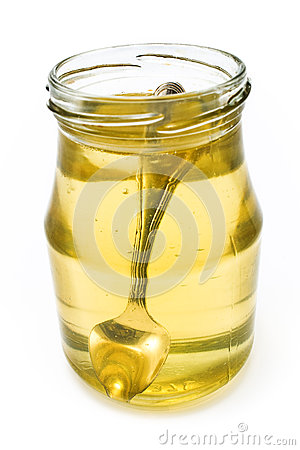 Honey in jar with silver spoon