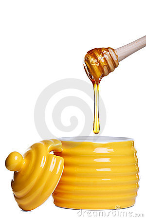 Honey pot and dipper isolated on white