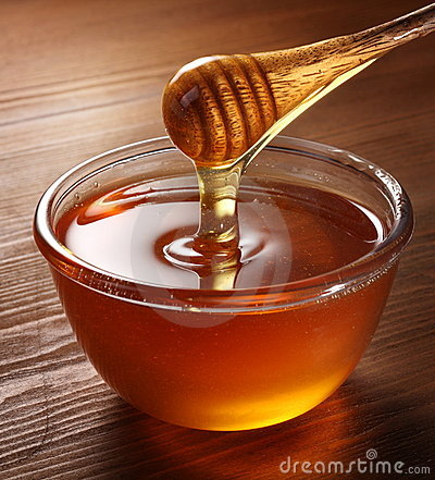 Free Honey Pouring From Drizzler Into The Bowl. Stock Photo - 16809230