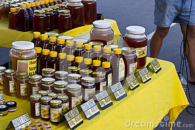 Honey for sale on street market table