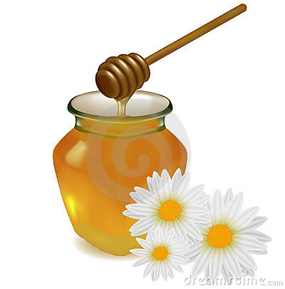 Honey with wood stick and flowers.