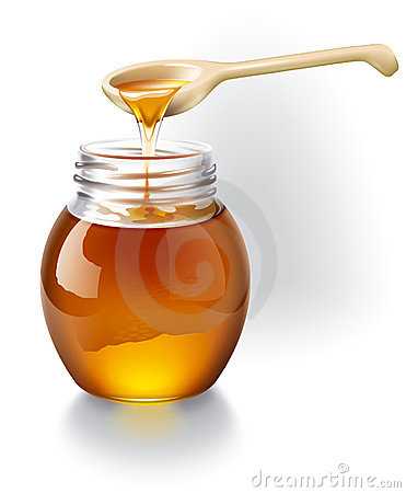 Honey with a wooden spoon.