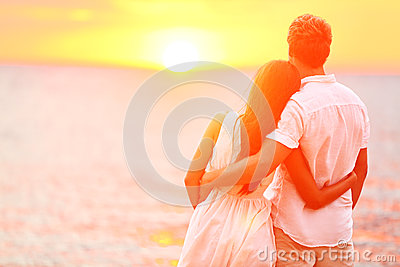 Honeymoon couple romantic in love at beach sunset