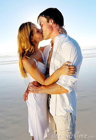 Honeymoon kiss on beach
