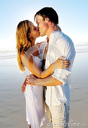 Honeymoon kiss on beach