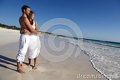 Honeymooners on idyllic beach