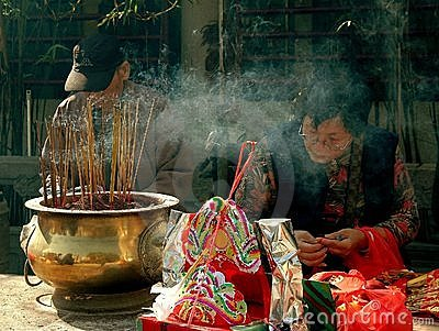 Hong Kong: Burning Incense at Temple Editorial Photography