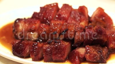 Hong Kong Chinese barbecue honey pork cuisine stock videobeelden