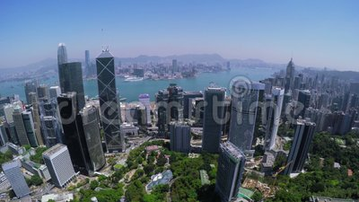 Hong Kong City Aerial Track Shot. Beautiful Clear Blue Sky. 4K Aerial view capturing the general Hong Kong and Kowloon Island. Left movement wide track shot