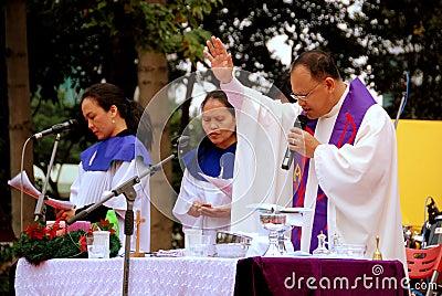 Hong Kong: Priest Celebrating Mass Editorial Image