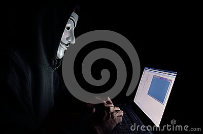A hooded computer hacker Editorial Stock Photo