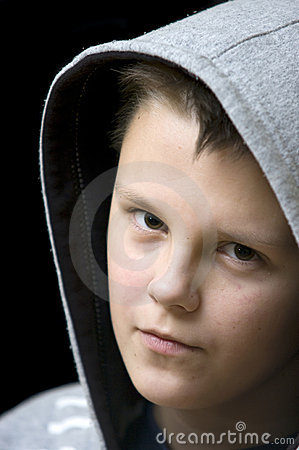Hooded teenage boy