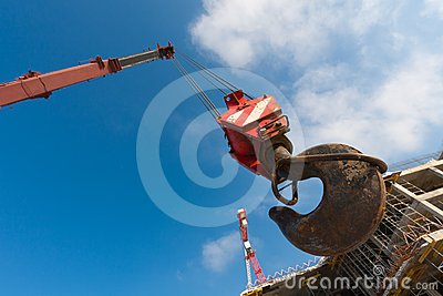 Hook of crane on background construction building