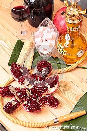 Hookah, wine, garnet  and sweets