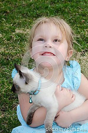 Hopeful child with kitten