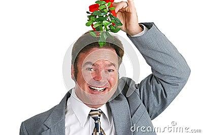Hopeful Guy Under Mistletoe