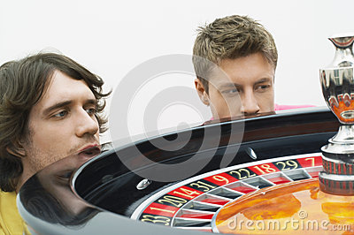 Hopeful Men Watching Roulette Wheel Spin