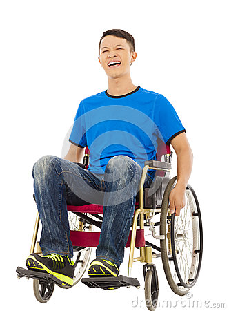 Hopeful young man sitting on a wheelchair