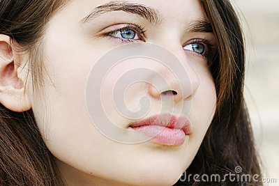 Hopeful young woman looking away