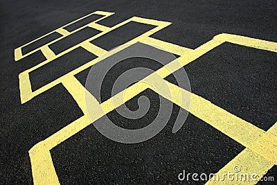 Hopscotch game yellow on pavement