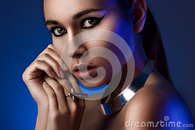 Horizontal close-up portrait of girl in blue light