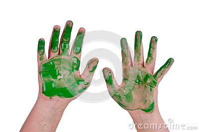 Horizontal image of a child s hands in green