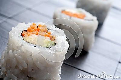Horizontal macro of 3 rolls of sushi