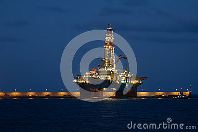 Horizontal oil drilling platform at night in Cana