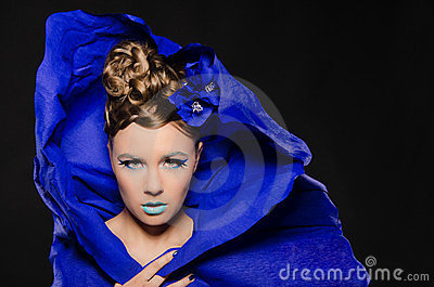Horizontal portrait of woman in blue