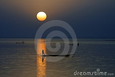 Horizontal silhouette of canoes on Niger River