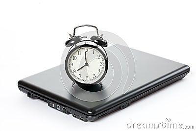horloge d 39 alarme et ordinateur portatif photographie stock image 14380432. Black Bedroom Furniture Sets. Home Design Ideas