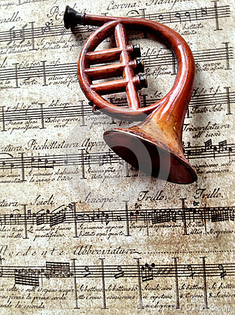 Horn ornament on old music background