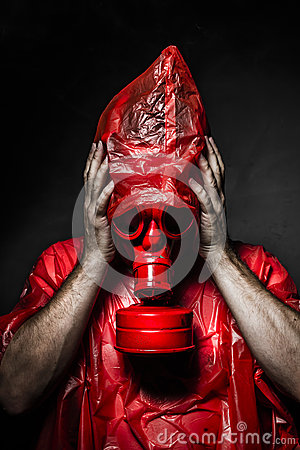 Horror concept, man with red gas mask.