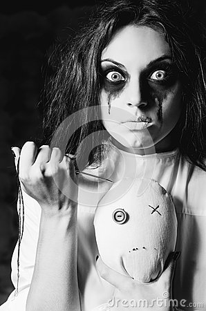 Free Horror Scene: The Strange Crazy Girl With Moppet Doll And Needle Royalty Free Stock Photo - 28679055
