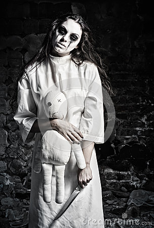 Free Horror Shot: Scary Monster Girl With Moppet Doll And Knife In Hands Royalty Free Stock Photos - 59257818