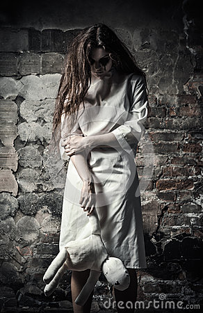 Free Horror Style Shot: Scary Monster Girl With Moppet Doll In Hands Stock Photo - 32950220